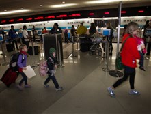 Holiday travelers make their way through Philadelphia International Airport.