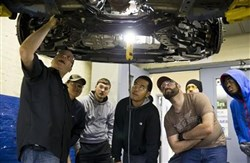 Assistant professor Dan Reed teaches automotive service technology students at the Community College of Philadelphia. The Labor Department said today that applications for unemployment benefits dropped 9,000 last week to a seasonally adjusted 280,000.