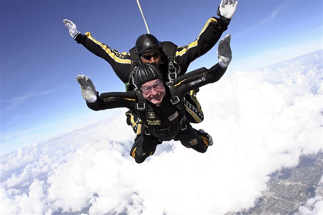 Former President George H.W. Bush is shown skydiving in his 80s.