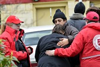Salvation Army personnel help to console friends and relatives of Norma McClain, 79, the woman who died in the fire, according to her son Mark Lundsford.