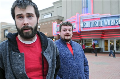 "Shawn Backo, left, and Gilbert Recker both from Dormont, thought that ""The Interview"" was ""very funny"" and were ""glad it was showing in Pittsburgh."""