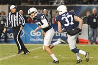 Penn State kicker Sam Ficken, center, celebrates after converting the game-winning extra point against Boston College in the Pinstripe Bowl at Yankee Stadium.
