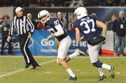 Penn State's new kicking candidates, including Chris Gulla (right), could likely learn a thing or two about their craft from former kicker Sam Ficken.