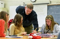 Teacher Bill Wolf helps students during a seventh grade math class at Pittsburgh South Brook in Brookline. Mr. Wolf participates in the DEbT-M math program.