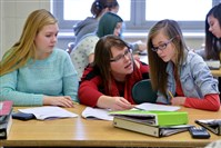 Teacher Cynthia Fisher helps students Alyssa Darden and Kassidy McKown during a seventh-grade math class at Pittsburgh South Brook in Brookline. Ms. Fisher participates in the DEbT-M math program.
