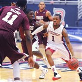 Duquesne's Derrick Colter goes for a basket against UMES players during Sunday afternoon's game at the Palumbo Center.