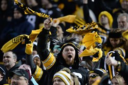 Steelers fans cheer on the team as they take on the Bengals at Heinz Field Sunday night.