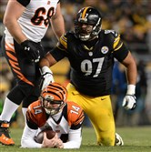 Andy Dalton, shown here getting sacked by the Steelers' Cameron Hayward at Heinz Field Sunday night, December 28, 2014, has been one of the big surprises of the 2015 NFL -- and fantasy football -- season.