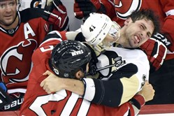 New Jersey Devils' Jordin Tootoo, left, and  Pittsburgh Penguins' Robert Bortuzzo fight during a game Monday, Dec. 29, 2014, in Newark, N..J.