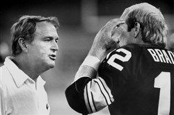 From the archives: Steelers coach Chuck noll speaks with quarterback Terry Bradshaw in this undated photo.
