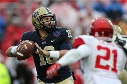 Pitt's Chad Voytik looks to pass during the Lockheed Martin Armed Forces Bowl game against the Houston Cougars at Amon G. Carter Stadium on January 2, 2015 in Fort Worth, Texas.