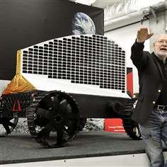 "William ""Red"" Whittaker, founder of the Field Robotics Center William ""Red"" Whittaker, founder of the Field Robotics Center at Carnegie Mellon University's Robotics Institute, talks about the solar-powered robot Polaris, which is displayed behind him, in 2012."