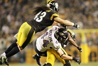Troy Polamalu leaps over the Ravens, Kyle Juszczyk during the  AFC Wild Card game at Heinz Field on January 3, 2015.