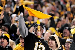 Steelers fans cheer during the fourth quarter of the AFC wild-card playoff game against the Ravens in January at Heinz Field.
