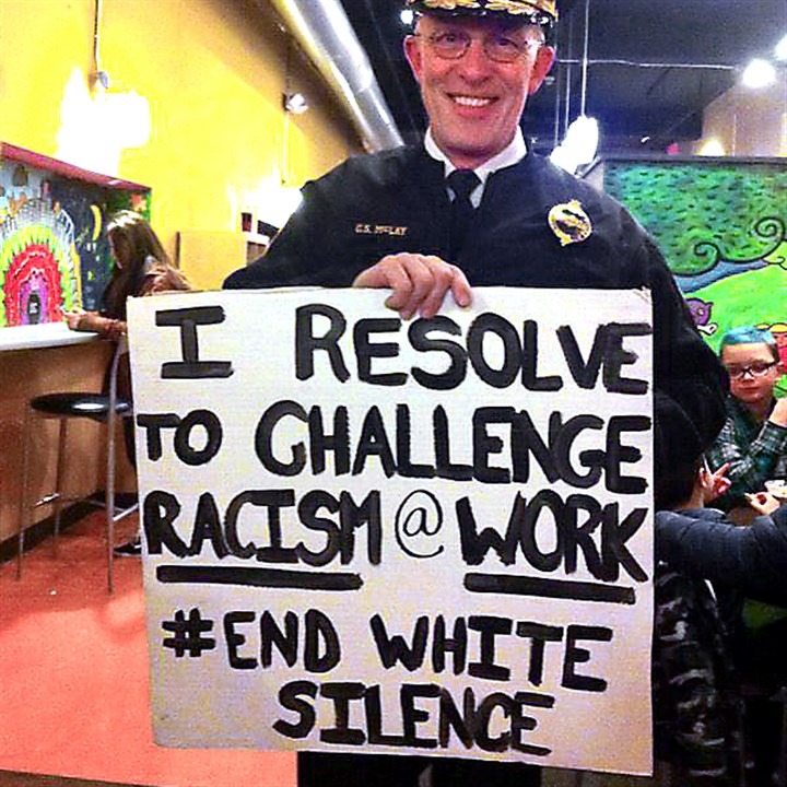 chief0104 Pittsburgh Police Chief Cameron McLay on New Year's Eve, holding a sign offered by the local activist group What's Up?! Pittsburgh. The photo was widely circulated on social media.