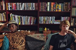 "RJ Cyler, left, and Thomas Mann in the childhood living room of writer Jesse Andrews in Point Breeze during a scene from ""Me & Earl & the Dying Girl."""