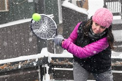 With the temperature holding steady at 11 degrees, Lisa Jeanson of Mars returns a ball during platform tennis league play in January in North Park.