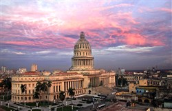 Morning breaks over the former capitol building in Havana, Cuba.  An exact replica of the U.S. Capitol, it is now abandoned.