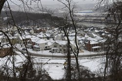As seen from Beechwood Boulevard, snow blankets a Squirrel Hill residential development overlooking the Monongahela River on Jan. 7.
