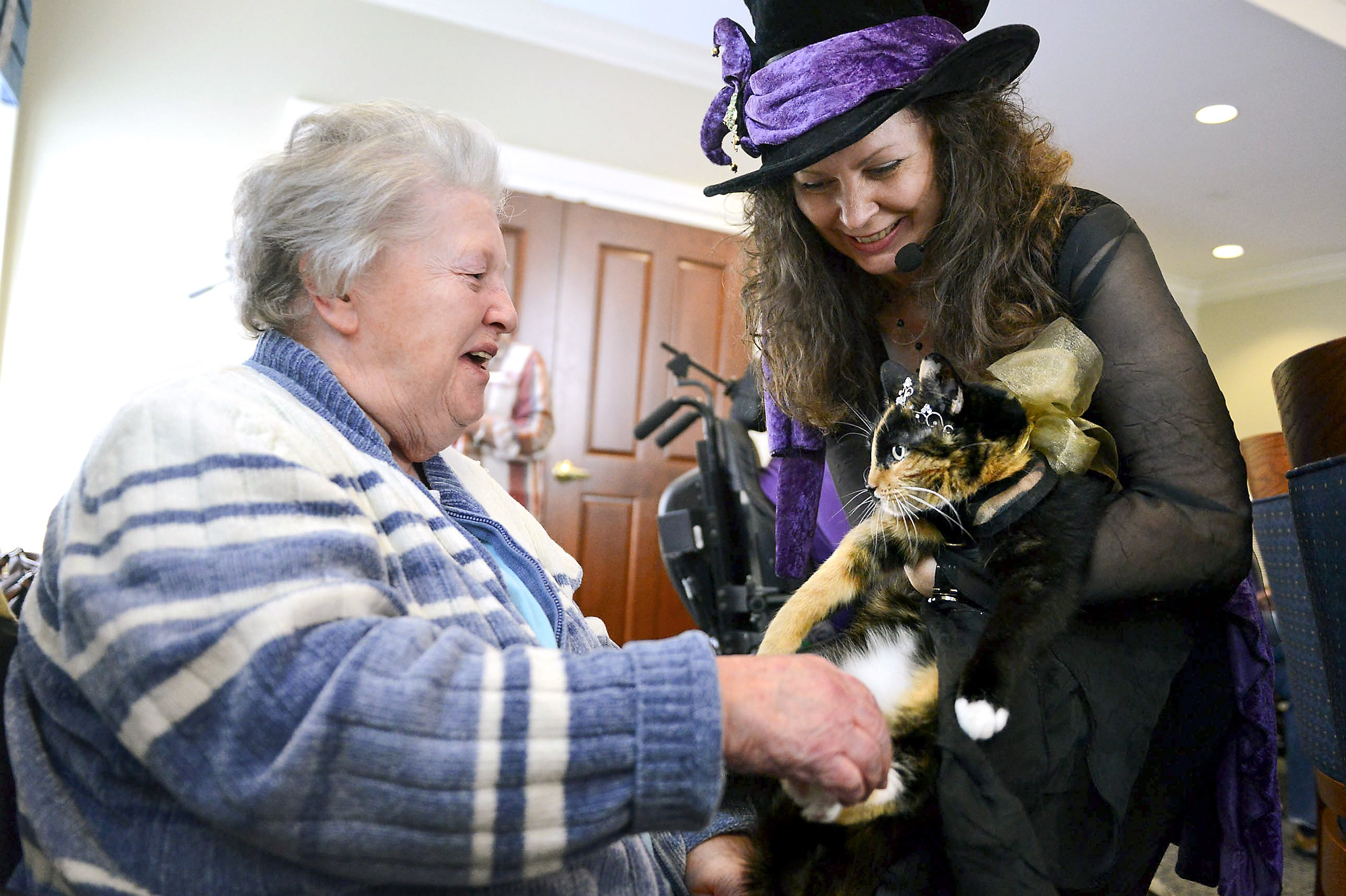 Karen McCandless of Butler lets Mary Wagner, 84, one of the residents of Concordia at Rebecca Residence in Allison Park, pet one of her two therapy cats, Tirzah, during a visit there on Wednesday, Jan. 7, 2015.
