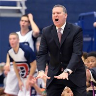 Duquesne head coach Jim Ferry calls out to his team as they take on Saint Joseph's in the second half Wednesday night, January 7, 2015.