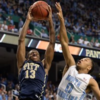 Pitt's Josh Newkirk drives to the basketball against North Carolina during an ACC tournament game in 2014.