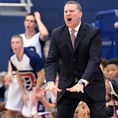 Duquesne head coach Jim Ferry calls out instructions to his team during a game against Saint Joseph's in January 2014.