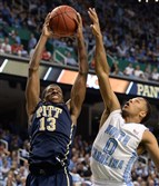 Pitt's Josh Newkirk drives to the net against North Carolina's Nate Britt in the second half of the quarterfinals of the ACC Tournament in Greensboro in 2014. He will transfer from the University Pittsburgh, the school announced.
