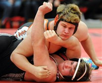 Bethel Park's Chris Pauly, top, pins Peters Townships Jacob Reardon in a meeting of powers in Section 2.
