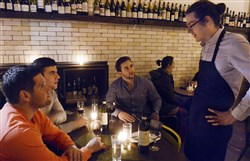 The state jobs report showed leisure and hospitality jobs were a bright spot in hiring over the last year. In this 2015 photo, left to right,  Andrew Sherman of Point Breeze, John Hudock, of Petersand Jeff Smillie of Squirrel Hill talk to Bar Marco waiter Justen Burrell of Lawrenceville.