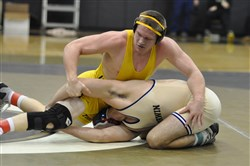 North Allegheny's Zach Smith, top, wrestling Norwin's Drew Phipps in a match last season, is the top seed at 195 pounds in the Allegheny County tournament.