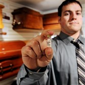 Andrew Weckman holds a small vial of his deceased father's DNA at Perman Funeral Home in Shaler.