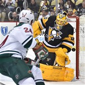 The Penguins' Marc-Andre Fleury makes a save on the Wild' Matt Cooke in the second period Jan. 13.