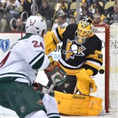 Marc-Andre Fleury makes a save against the Minnesota Wilds  Matt Cooke Tuesday at the Consol Energy Center.
