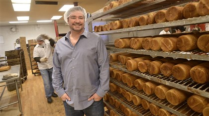 Scott Baker of 5 Generation Bakers shows off a rack of Jenny Lee cinnamon bread fresh from the oven. The company brought the Jenny Lee brand name out of retirement a few years ago and now sells the bread in stores across 20 states.
