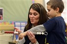 Kim Dennis of the Center for Educational Leadership works with first grader Gabriel Mantick as she teaches a demonstration math class employing math racks at Pittsburgh Woolslair PreK-5.