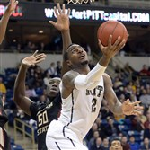 Pitt's Michael Young drives to the hoop against Florida State's Michael Ojo during a January game.