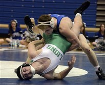 Jake Wentzel of South Park, on top, on his way to a technical fall in the 152 pound match against Christian Dedi of South Fayette.