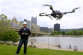 Dick Zhang, CEO of Identified Technologies, flies one of the company's drones on the North Shore. The drone is a flying robot customized to collect images, data or gas readings.