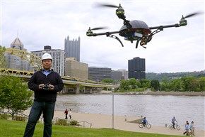 Dick Zhang, CEO of Identified Technologies, flies one of the company's drones on the North Shore. The Drone is a flying robot to customized to collect images , data or gas readings.