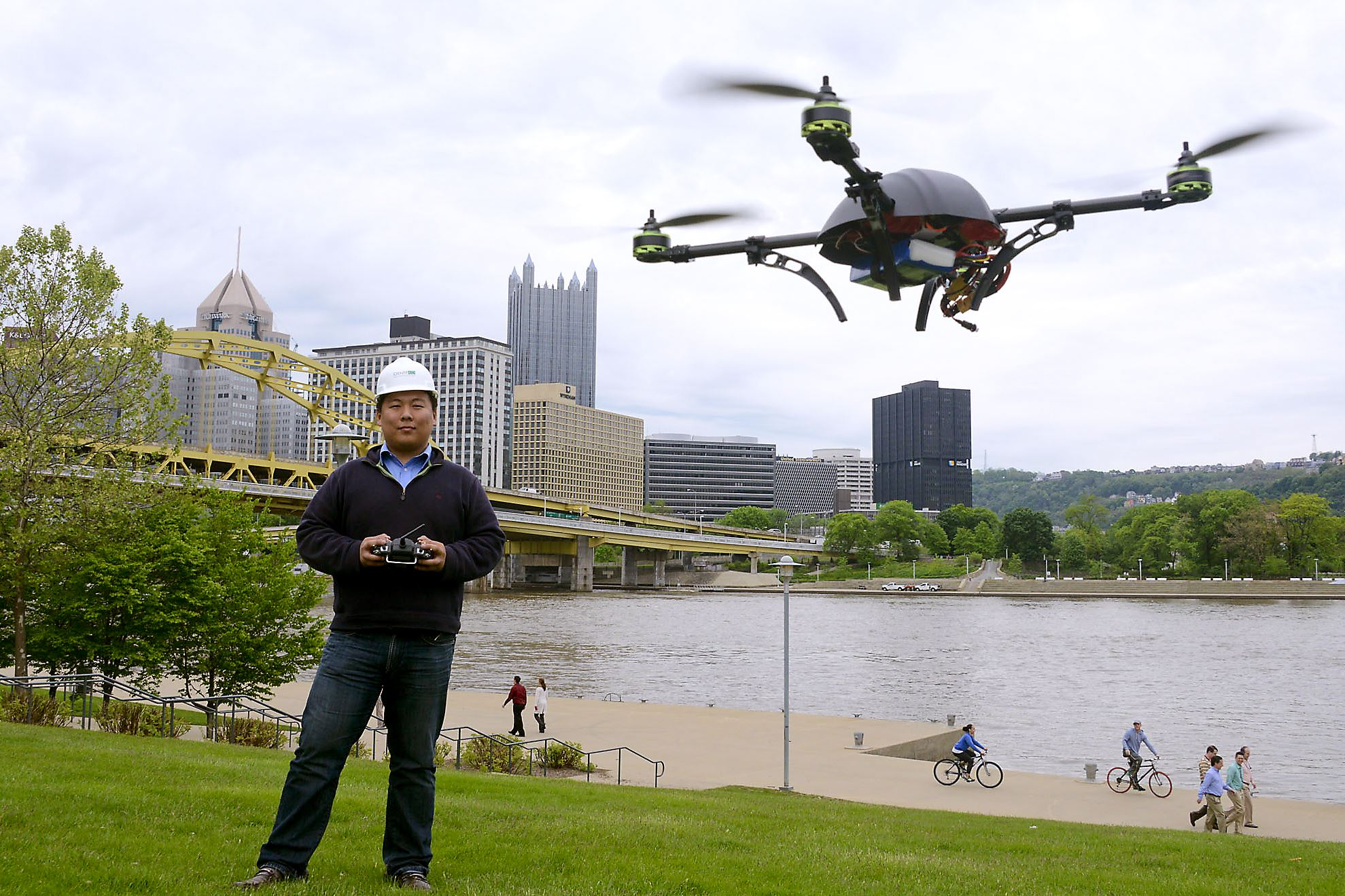 20150129dsDrones Dick Zhang, CEO of Identified Technologies, flies one of the company's drones on the North Shore. The drone is a flying robot customized to collect images, data or gas readings.