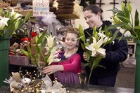 Bella Carotto, 9, helps her mother Loren Carroto do a flower arrangement at the family business, Monessen Florist.  Bella has pediatric kidney stones.