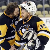 Jeff Shilling, right, of Murrysville shakes hands with teammate Chad Duff of Lynchburg, Va., after a game at the Mario Lemieux Fantasy Hockey Camp at Consol Energy Center on Friday.