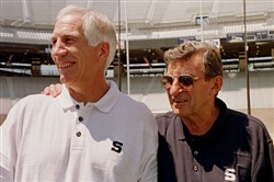 In his letter to the Penn State community, Eric Barron said there is no evidence to support claims that Joe Paterno, right,  knew in 1976 about a child's claim of sex abuse against Jerry Sandusky, left.