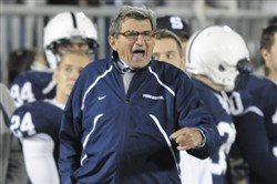 Penn State head coach Joe Paterno tries to fire up his players against Ohio State at Beaver Stadium in November 2009. Ohio State won 24-7.