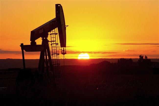 This August 21, 2013 file photo shows an oil well near Tioga, North Dakota. Oil prices January 5, 2015, fell below $50 per barrel for the first time since 2009 on a rocky day in global financial markets.