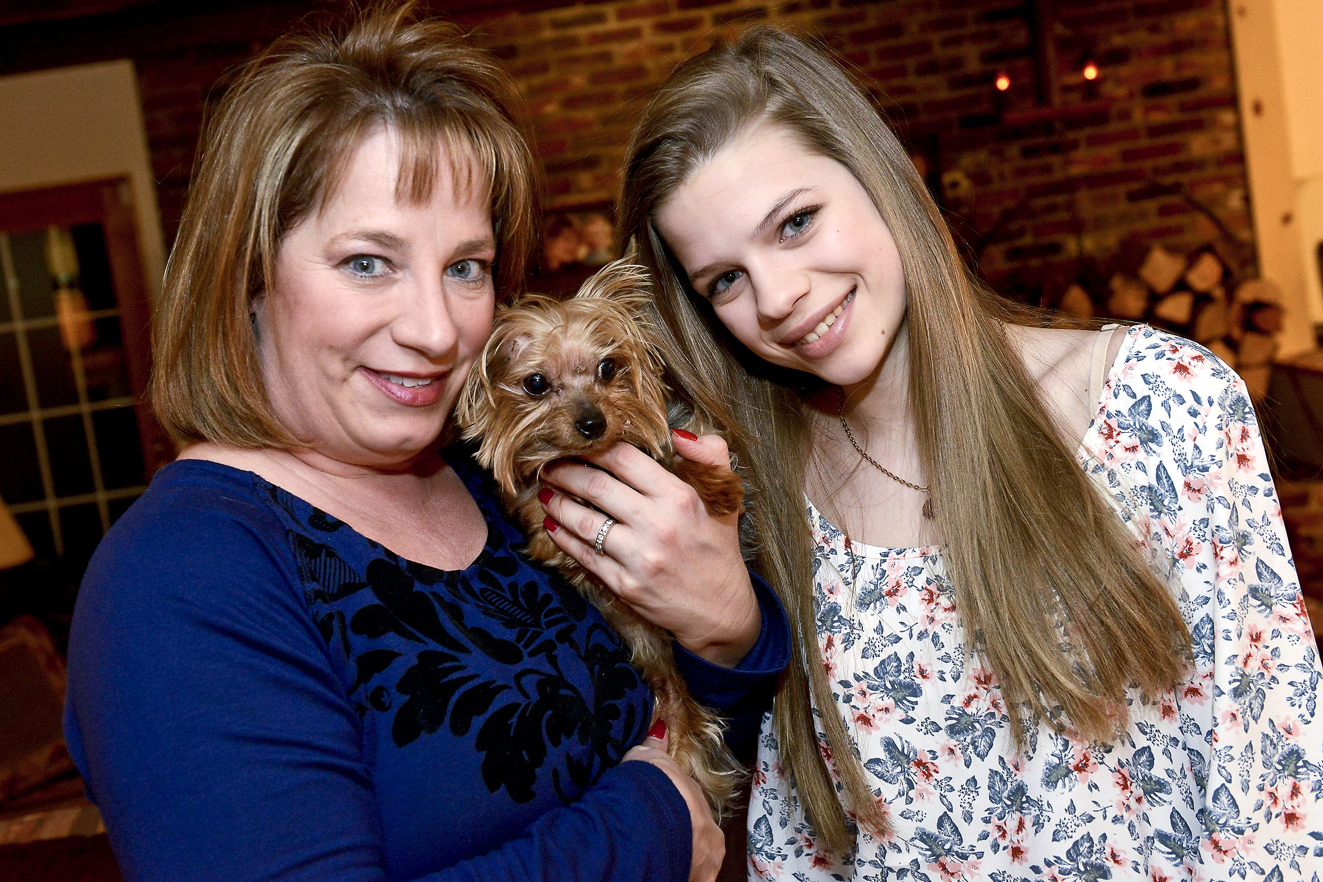 20150114rldYorkie01 Lori Timczyk with her daughter Jessica, 15, and Rocky, their 4-pound Yorkshire terrier who survived an attack from a hawk.