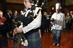 Bagpiper Bud Brizuela leads Pittsburgh Golf Club Executive Chef Mike Wagner, carrying the haggis.