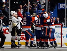 The New York Islanders celebrate a goal by Kyle Okposo at 17:29 of the third period Friday night against the Penguins at Nassau Veterans Memorial Coliseum.
