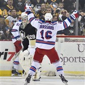 The Penguins Marc-Andre Fleury looks over at the Rangers' Derick Brassard after assisting on a goal by Rick Nash in the first period at Consol Energy Center.